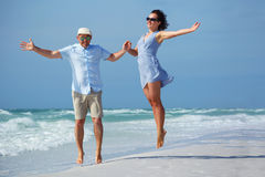 Young couple having fun at tropical beach, Siesta Royalty Free Stock Images