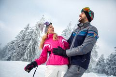 Young couple having fun on winter vacation on the mountain. Happy young couple having fun on winter vacation on the mountain Stock Image