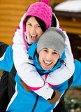 Young couple having fun during winter vacations Royalty Free Stock Photo