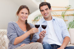 Young couple having a glass of red wine Royalty Free Stock Images