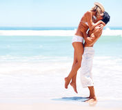 Young couple having a good time on a beach Royalty Free Stock Photography