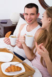 Young couple having healthy breakfast Royalty Free Stock Photo