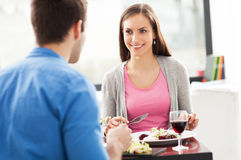 Couple dining in restaurant. Young couple having meal in restaurant Stock Photo