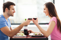 Couple having toast in restaurant Stock Photography