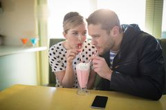 Couple having milkshake in restaurant Royalty Free Stock Image