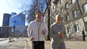 Young couple having morning run in the city stock footage