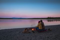 Camping vibes at autumn Morley lake during sunset time, bonfire, North America, Yukon, British Columbia, Canada royalty free stock photography