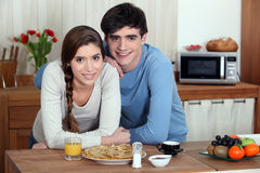 Young couple having pancakes Stock Photos