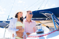 Young couple having a party on a luxury sailing boat at summer Royalty Free Stock Image