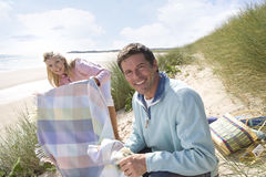 Young couple having picnic at beach Stock Photo