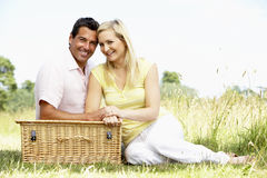 Young couple having picnic in countryside Royalty Free Stock Image