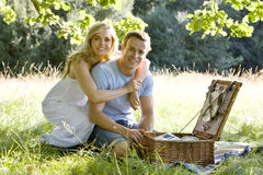 A young couple having a picnic, embracing Stock Images