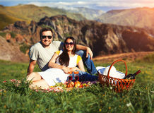 Young couple having picnic Royalty Free Stock Photos