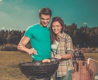 Young couple having picnic Stock Photo