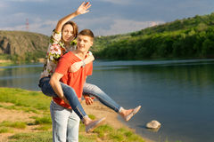 Young couple having a piggy back ride Stock Image