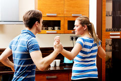 Young couple having quarrel in the kitchen Royalty Free Stock Photography