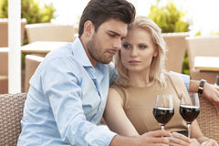 Young couple having red wine at outdoor restaurant Royalty Free Stock Photo