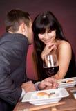 Young couple having romantic conversation. At restaurant Stock Photo