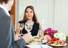 Young couple having romantic dinner with champagne Royalty Free Stock Photography