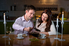Young couple having romantic dinner on the dinner table at home Stock Image