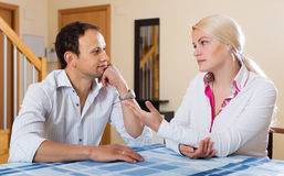 Young couple having serious conversation Royalty Free Stock Photo