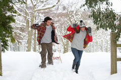 Young couple having snowball fight