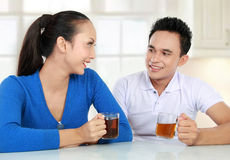 Young couple having a tea. Cheerful young couple having a tea together Stock Photo