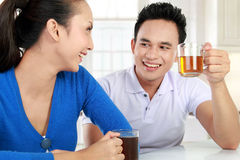 Young couple having a tea Stock Photos