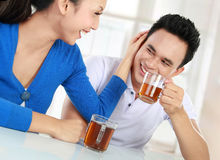 Young couple having a tea. Cheerful young couple having a tea together Stock Images