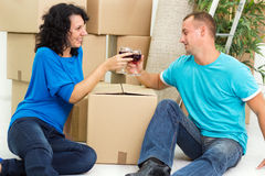 Young couple having a toast in new home Stock Images