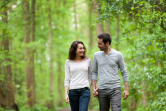Young couple having a walk in a forest Stock Image