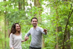 Young couple having a walk in a forest Stock Photo
