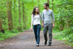 Young couple having a walk in a forest Stock Photos