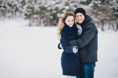 Young couple having a walk in snowy countryside Royalty Free Stock Photos