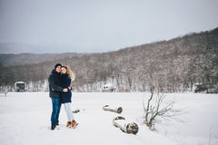 Young couple having a walk in snowy countryside Royalty Free Stock Photo