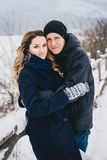 Young couple having a walk in snowy countryside Stock Photos