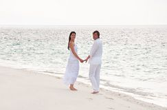 Young couple having a walking on the sea sho Royalty Free Stock Photo