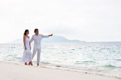 Young couple having a walking on the sea sho Stock Image