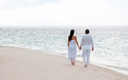 Young couple having a walking on the sea shore Royalty Free Stock Photos