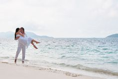 Young couple having a walking on the sea shore Royalty Free Stock Image