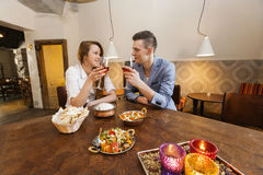 Young couple having wine at restaurant table Stock Image