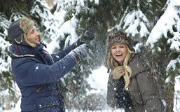 Young couple having winter fun royalty free stock image