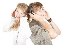 Young couple in headphones Stock Photos