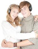 Young couple in headphones Royalty Free Stock Images