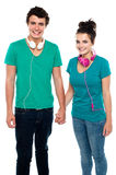 Young couple with headphones around their necks Stock Photo