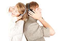 Young couple in headphones listening music Stock Image