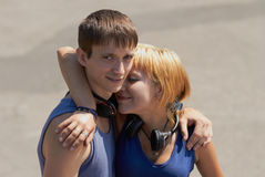 Young couple with headphones posing Stock Images