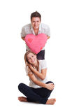 Young couple with heart Royalty Free Stock Photos