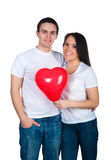 Young couple with a heart Royalty Free Stock Photography