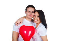 Young couple with a heart Royalty Free Stock Photos